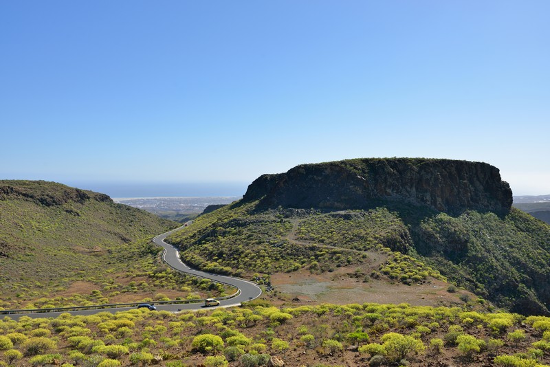 Long, sweeping road in the mountains of Gran Canaria looking down to the sea