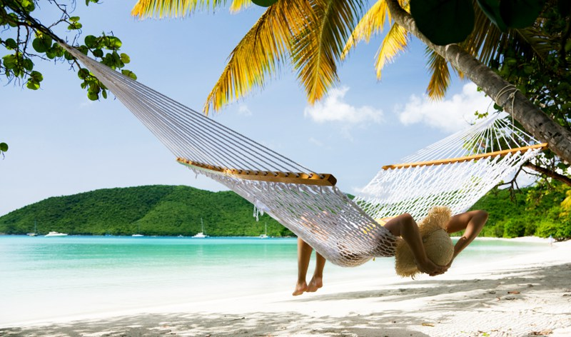 Relaxing in a hammock next to the beach