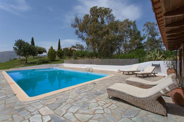swimming pool and sun loungers greece