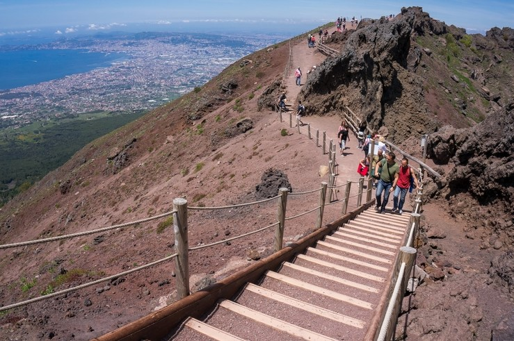 Tourists walking on Mount Vesuvius in Italy