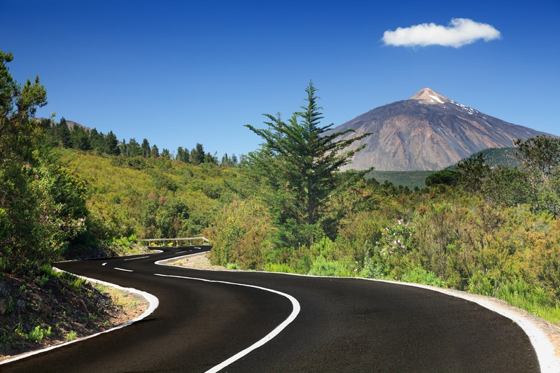 Tenerife. Winding mountain road in beautiful landscape on Tenerife showing the volcano Teide