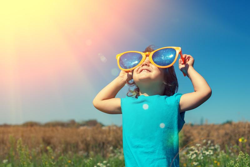 little girl enjoying sunshine sunglasses