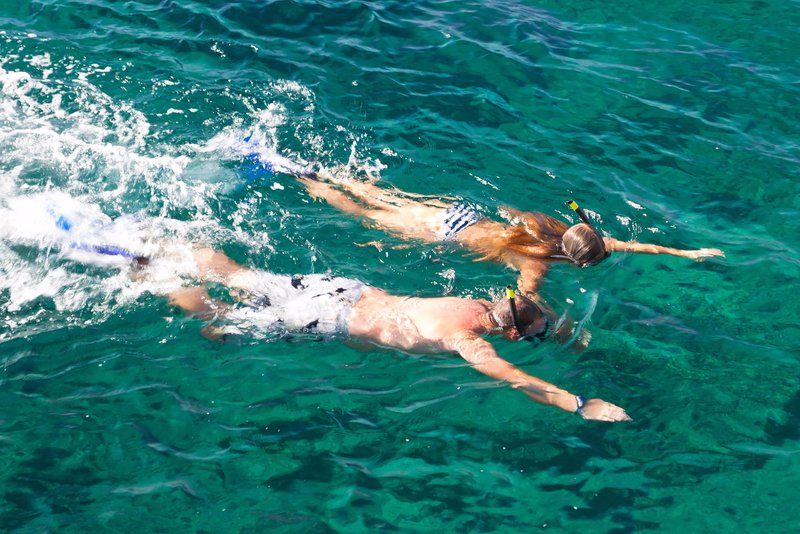 Snorkeling in transparent waters in Cova des Vell Mari, an arms length from Port de Sóller
