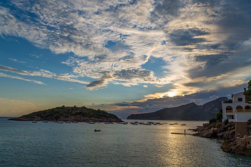 Cloud strewn sunset behind the Serra de Tramuntana mountain range and Sa Dragonera island