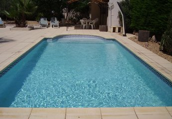 Villa in Maraussan, the South of France: Pool looking towards summer kitchen