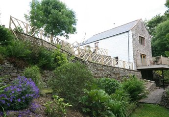 Cottage in Cairn Valley, Scotland: View of gable end of cottage showing balcony