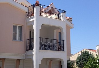 Apartment in Yesilkent, Turkey: Exterior of apartment, showing lower level shaded balcony, and upp..