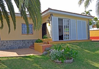 House in Las Cuevas, Tenerife: Front door opens into airey interior with french doors onto the law..