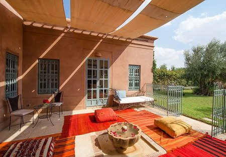 Villa in Touihina, Morocco: Patio area outside living room set up with day beds, sofas and rugs