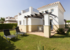 Rear view of villa with sunny private garden and quality sun loungers