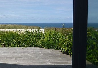 House in Bude, England: Deck and sea view from lounge /dining room