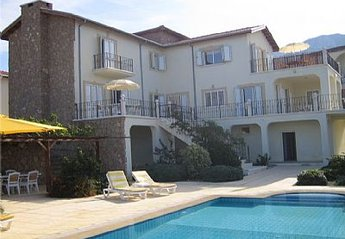 Villa in Edremit, Cyprus: Villa, pool and bar/BBQ with mountains behind