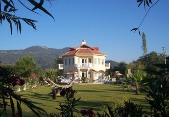 Villa in Dalyan, Turkey: landscaped gardens with private bar
