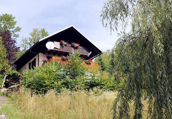 Country House in Studenca, Slovenia: Exterior of the property from the garden in Summer.