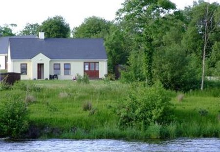 Cottage in Portinode, Northern Ireland: Cottage from water