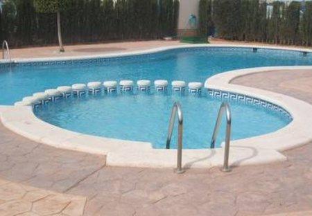 Apartment in Urbanización La Regia, Spain: Warm inviting private shared pool
