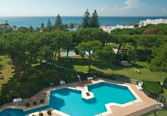 Apartment in Spain, Puerto Banús: Partial aerial view of Club Playas Del Duque gardens and beach ..