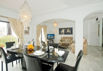Apartment in Puerto Banús, Spain: Elegant Dining with crystal glassware and fine tableware with v..