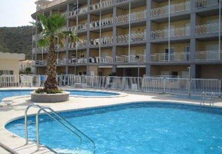 Apartment in Urbanización Cala d'Or, Spain: The communal swimming pools.
