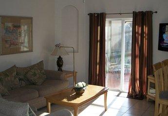 Villa in Regal Oaks, Florida: Living area and screened patio
