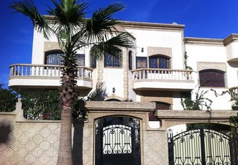 Villa in Sale, Morocco: front facade, entrance to ground floor apartment and garage