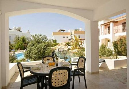 Apartment in Tombs of the Kings, Cyprus: Shaded Terrace out to Pool