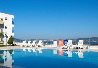 Apartment in Gulluk, Turkey: Pool with panoramic view of bay