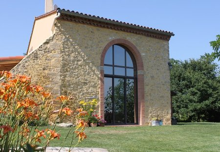 Farm House in Pech-Luna, the South of France: Front view with double height window looking towards..