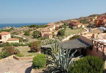 Apartment in Canneddi, Sardinia: The Blue Sea Provides The Perfect Background To Our Lovely Village