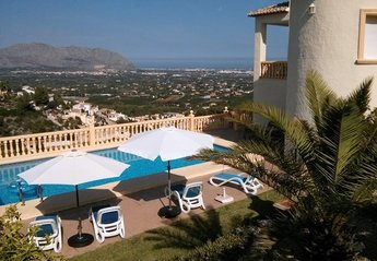 Villa in Muntanya La Solana I, Spain: Villa and pool with view to valley and coast