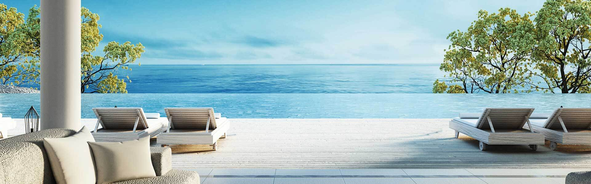 View of an infinite pool from a villa